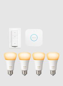 Vier Philips Hue White & Ambiance Glühbirnen mit Fernbedienung und Bridge