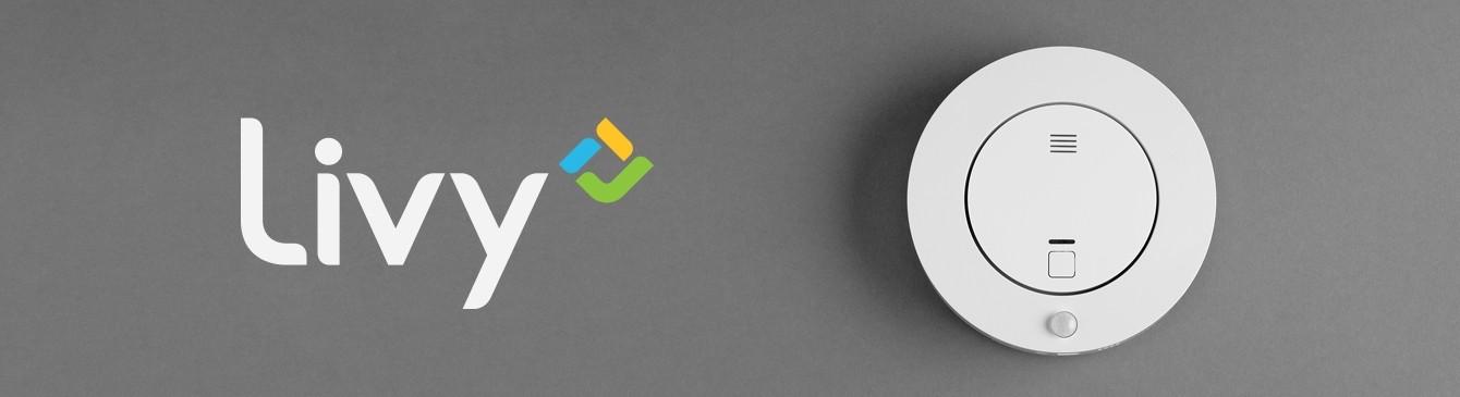 Livy All-In-One Sicherheitssystem neben Livy Logo